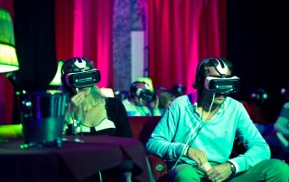 two people wearing vr headsets in cinema